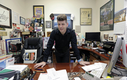 In this photo taken Monday, March 7, 2016, Jason Parsley, the editor of the South Florida Gay News, poses for a photo at his office in Wilton Manors, Fla. Parsley, an editor for a gay newspaper in Florida, faced numerous obstacles as he tried to learn how often police officers used derogatory terms in their emails. The Associated Press featured Parsley's effort in 2015 during Sunshine Week and then joined forces with his newspaper, the South Florida Gay News. The goal was to determine whether such police emails were public and, if so, how the public and media could obtain them in a timely and cost-efficient way. (AP Photo/Alan Diaz)