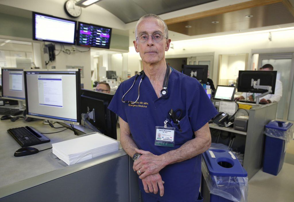 ADVANCE FOR USE MONDAY, MARCH 13, 2017 AND THEREAFTER-Dr. Garen Wintemute an emergency room physician at the University of California, Davis, Medical Center, poses for a photo at the hospital in Sacramento, Calif., on Thursday, March 9, 2017. Wintemute, who has researched gun violence and firearms industry, worked with colleagues to download public records from the Bureau of Alcohol, Tobacco and Firearms and other federal agencies after the inauguration of President Donald Trump. He and others feared the information might disappear from federal websites. (AP Photo/Rich Pedroncelli)
